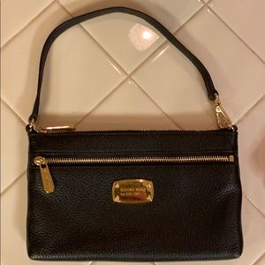 Michael Kors black and gold wristlet.